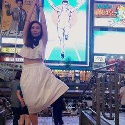 KrisYoga - Travel Yoga, Tree Pose in front of Glico Man, Osaka